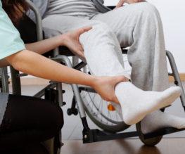 Nurse-patient-wheelchair-leg-injury